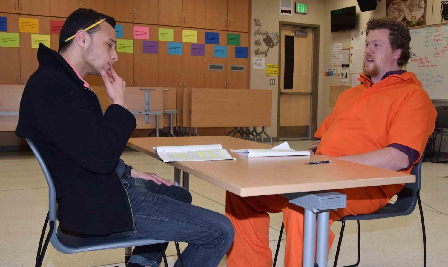 Olene Togialu (Greg Pierotti) interviews Chris Telford who plays convict Aaron McKinney in the school spring play.