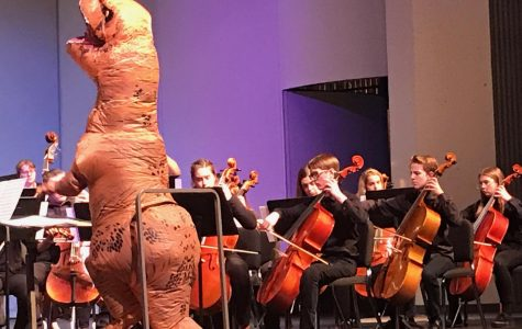 Dinosaur directs orchestra at final concert
