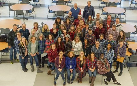 Staff dons flannel for family portrait after meeting