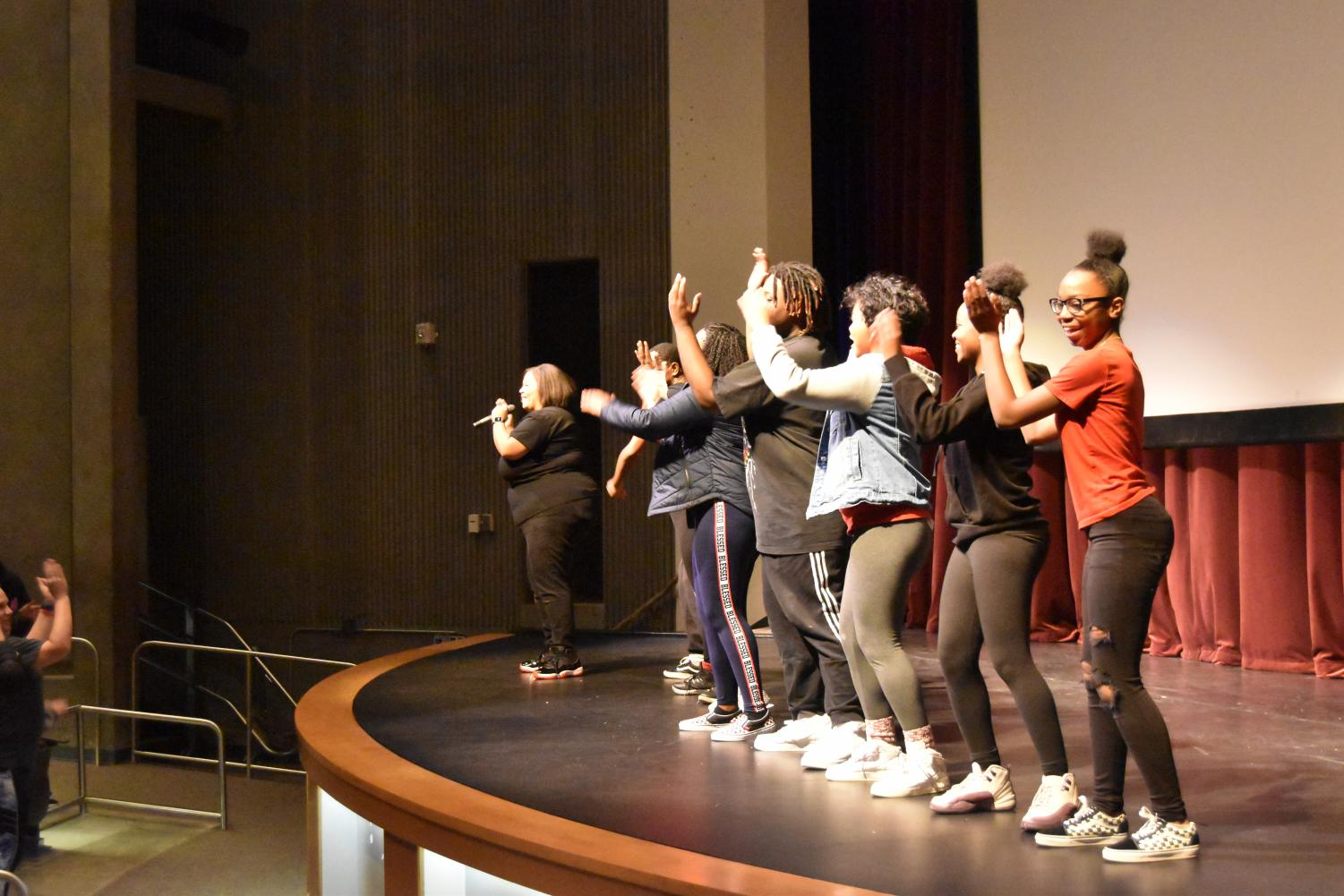 BSU+members+teaching+fellow+students+a+part+of+a+step+routine+that+they+all+performed+together.+This+is+showing+how+unity+can+happen+from+small+things.
