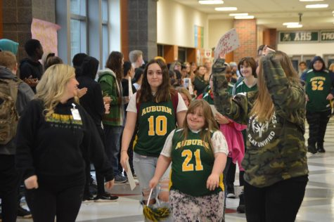 Senior, Lizzy Souers, Leads her team in the march.