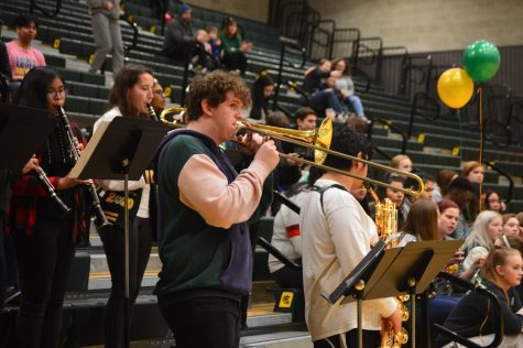 Trojan alumni band leaders, Kasidy Love and Gabriel Kindell, playing with the band.